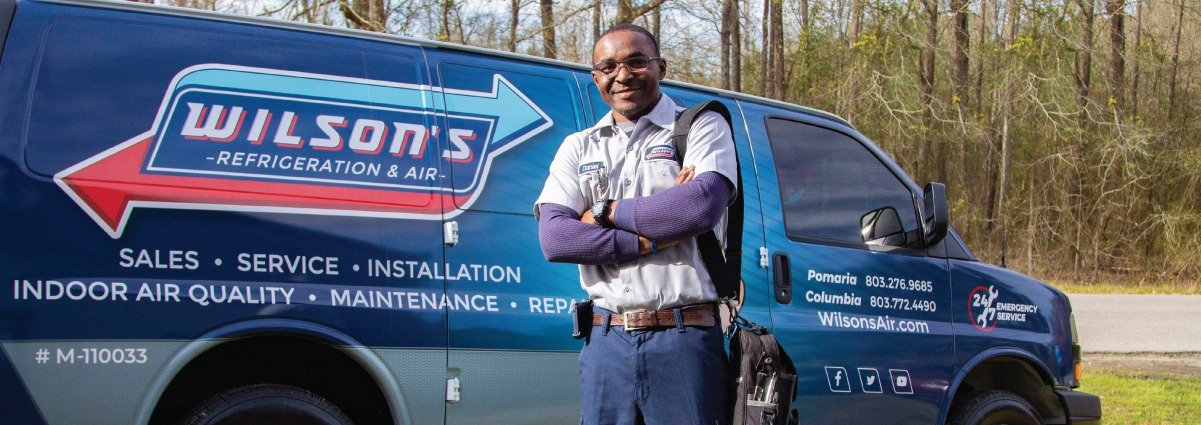 Heating & Air Technician in Front of Wilson's Truck